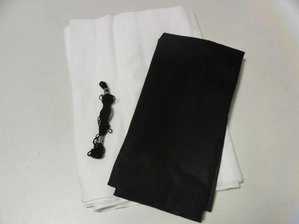 白と黒の布と、黒い糸